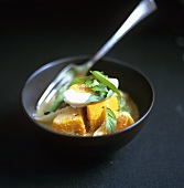 Pumpkin dish with boiled egg in coconut curry sauce