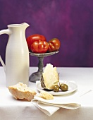 Still life with white bread, Parmesan, wine jug & tomatoes