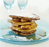 Pancakes with fried apple slices and maple syrup