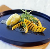 Grilled mango slices with mango sorbet and mint