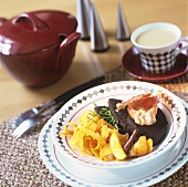 Black pudding with chives, bacon, noodles and potatoes