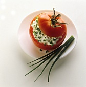 Tomato stuffed with soft cheese