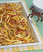 Sausage slices & chips with melted cheese and a toy horse