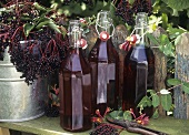 Still life with elderberry juice and elderberries
