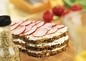 Soft cheese & radishes in wholemeal triple-decker sandwich