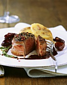 Peppered venison loin steak with red wine shallots