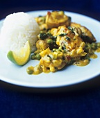 Fish curry with spinach and peas