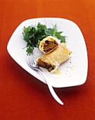 Yufka pastry roll with sweet potato and mushroom filling