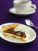 Vanilla pecan pie with ice cream