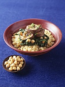 Beef roulade with spinach and chick-peas on couscous