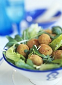 Deep-fried fish balls with salad