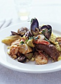 Couscous with seafood and Merguez sausage
