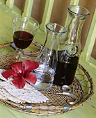 Still life with red wine, water, crispbread and flower