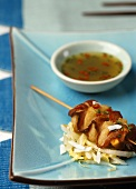 Satay with bacon and coconut chilli sauce