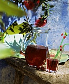 Cherry juice in glass and jug