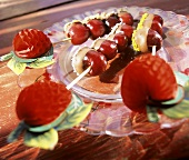 Skewered cherries dipped in chocolate, coconut & pistachio
