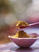 Spice mixture in small dish and on spoon