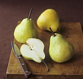 Pears with knife on a chopping board
