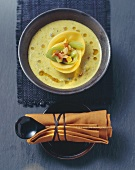 Coconut soup with vegetables and mango