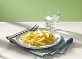 Chips and a glass of water with ice cubes