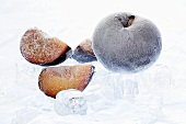 Frozen plums with ice cubes