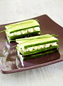 Cucumber layered with soft cheese