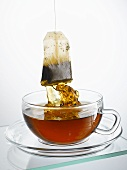 Taking tea bag out of cup
