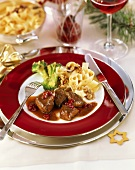 Venison goulash in cranberry sauce with ribbon pasta & broccoli