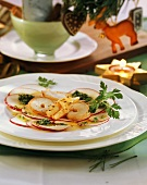 Shrimp carpaccio with thin apple slices and parsley pesto