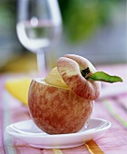 Hollowed-out peach filled with sorbet
