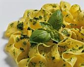 Ribbon pasta with pesto and basil