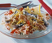 Bulgur wheat salad with tomatoes and marinated anchovies