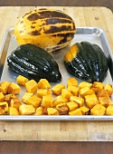 Acorn squash and spaghetti squash on a baking tray