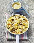 Pan-cooked pasta & mushroom dish with eggs & cheese topping