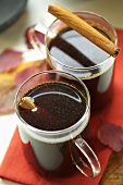 Mulled wine with cinnamon sticks