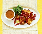 Fried tofu slices with strips of pepper