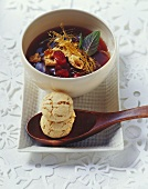 Cranberry soup with caramel strands and amarettini