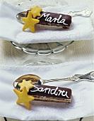 Layered chocolate fingers with chocolate icing & marzipan stars