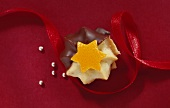 Chocolate-dipped Viennese rosette with orange peel star