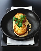 Oven-baked bacon-wrapped fish cakes with curry sauce