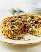 Courgette quiche with anchovies
