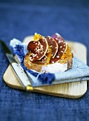 Toast topped with pepper confit, smoked duck breast & sesame oil