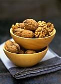 Walnuts in wooden bowls