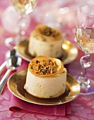 Turned-out caramel mousse with chopped nuts