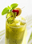 Kiwi fruit and banana drink with fruit on cocktail stick
