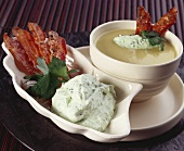 Creamed potato soup with celery cream and bacon