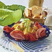 Cabbage salad with oranges and ham