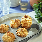 Puff pastry purses filled with turkey & ham in a muffin tin