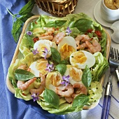 Hard-boiled eggs in mustard sauce with shrimps on lettuce