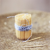 A bundle of toothpicks tied with kitchen string
